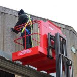 Using forklift cages to improve safety when working at height